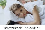 depressed young woman lying in... | Shutterstock . vector #778538158