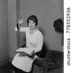 Small photo of Aimee Semple McPherson, in a preaching pose, Feb. 14, 1927. She had recently emerged from a prosecutorial investigation of her alleged 1926 kidnap and disappearance