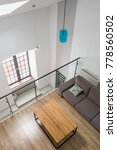 Small photo of Top view of a mezzanine living room with table and couch