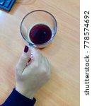pretty woman's hand holding a... | Shutterstock . vector #778574692