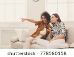 smiling young women relaxing... | Shutterstock . vector #778580158