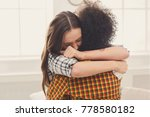 woman hugging her depressed... | Shutterstock . vector #778580182