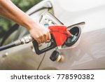 hand refilling the car with... | Shutterstock . vector #778590382