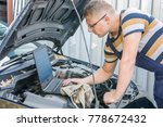 car mechanic with diagnostic... | Shutterstock . vector #778672432