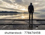man standing at the shore ...   Shutterstock . vector #778676458