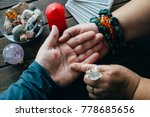 Small photo of Palmistry fortune teller reads lines on man hand or palm to tell his future, top view, toned