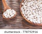 raw organic white beans  ... | Shutterstock . vector #778752916