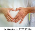 heart shaped hands over a belly ... | Shutterstock . vector #778759516