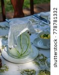 Small photo of Close up of luxurious dinning, fancy water pitcher with protective cover
