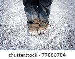 Dirty And Bare Child's Feet On...