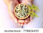 Girl hands holding herbal...