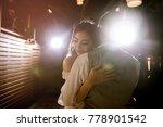 asian woman hugging her... | Shutterstock . vector #778901542