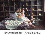 family in bed. morning. mom ...   Shutterstock . vector #778951762