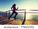 sporty fitness female runner... | Shutterstock . vector #778962502