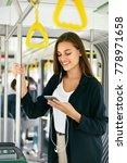 woman listening music on phone... | Shutterstock . vector #778971658