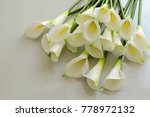 bunch of arum lily on white... | Shutterstock . vector #778972132