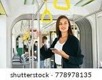 woman listening music on phone... | Shutterstock . vector #778978135
