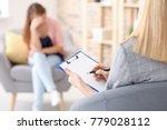 female psychologist working... | Shutterstock . vector #779028112