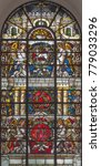 Small photo of LONDON, GREAT BRITAIN - SEPTEMBER 14, 2017: The angels with the IHS initials and Lamb of God on the stained glass in church St. Vedast alias Foster (1884).