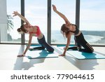 two of asian woman doing yoga... | Shutterstock . vector #779044615