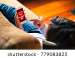 woman holding a mobile phone... | Shutterstock . vector #779083825
