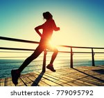 sporty fitness female runner... | Shutterstock . vector #779095792