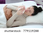 young sick woman laying in bed | Shutterstock . vector #779119288