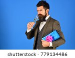 man in smart suit on blue... | Shutterstock . vector #779134486