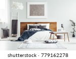 silver painting on white wall... | Shutterstock . vector #779162278