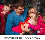 the father with daughters... | Shutterstock . vector #779177422