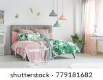 pastel bedding on stylish bed... | Shutterstock . vector #779181682