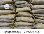 Small photo of Traditional Style Brined Vine Leaves Wraps For Sale on Market stall