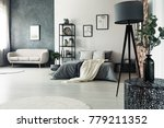 designer table and grey lamp in ... | Shutterstock . vector #779211352