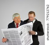 Small photo of Caricature of United States President Donald Trump and Russian President Vladimir Putin reading Fake News