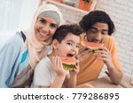the arab family is eating a... | Shutterstock . vector #779286895