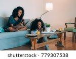 happy young two black women... | Shutterstock . vector #779307538