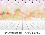 empty wooden table with light... | Shutterstock . vector #779311762