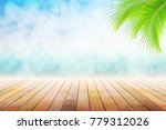 empty wooden table and palm... | Shutterstock . vector #779312026