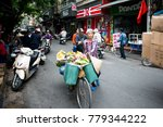 Small photo of Hanoi - Vietnam. December 03, 2015. Street trading in Old Quarter in Hanoi, Vietnam. Vietnam's capital races to make up for time lost to the ravages of war and a government that as recently as the 199