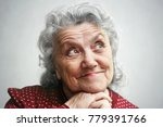 smile and thinking old woman... | Shutterstock . vector #779391766