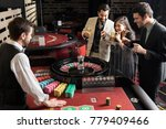 group of roulette players... | Shutterstock . vector #779409466