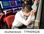 unlucky young man feeling sad... | Shutterstock . vector #779409628