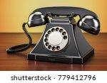 Retro Black Telephone On Woode...