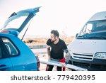 surfer puts surfboard into car... | Shutterstock . vector #779420395