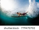 young surfer dives under the... | Shutterstock . vector #779470702