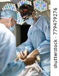 surgeon is using a laser... | Shutterstock . vector #779479276