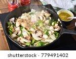sauteing onionis  mushrooms ... | Shutterstock . vector #779491402