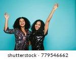 two happy girlfriends raised...   Shutterstock . vector #779546662