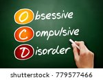 Small photo of OCD - Obsessive Compulsive Disorder, acronym health concept on blackboard