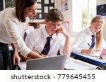 female teacher helping pupil... | Shutterstock . vector #779645455